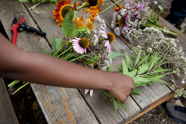 Students at Eastern Senior High School in Washington, D.C., trim bouquets to sell at the farmers market.