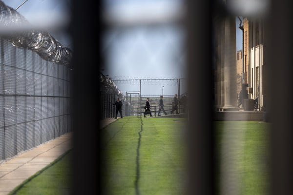 White House staff walk into the El Reno Federal Correctional Institution in El Reno, Okla.