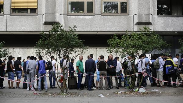 Refugees line up to apply for asylum at a reception center in Berlin, Germany. Figures released last week showed that about 180,000 asylum applications were filed in the first six months of 2015, more than twice as many as in the same period last year.