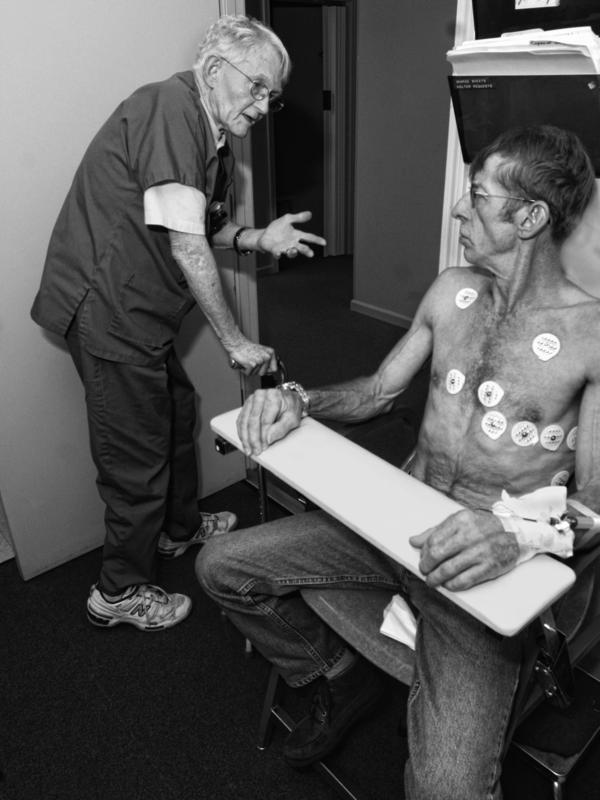 Donald Rasmussen advises a coal miner who qualified for Federal Black Lung Compensation at his West Virginia clinic in 2006.