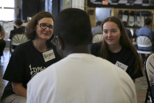 Inmates talk with professors about how to teach classes in the Inside-Out program, where half the students are prisoners and half are traditional college students.