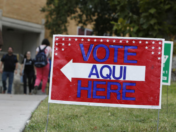 A sign shows the way to a polling station in Austin, Texas. A federal appeals court has knocked down a state voter ID law.