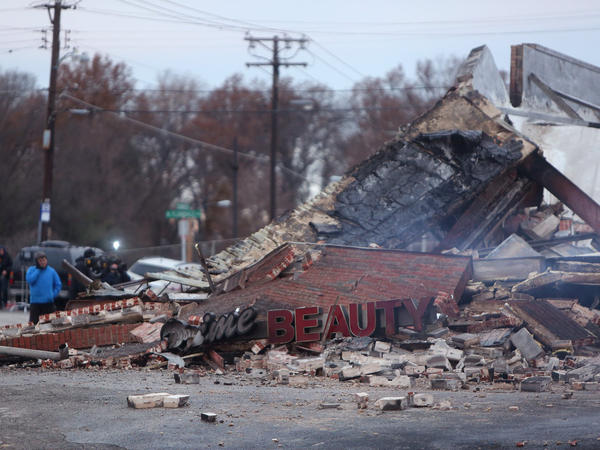 The smoldering remains of a beauty supply store in Ferguson, Mo., in November. Unrest gripped the city after a grand jury decided not to indict police officer Darren Wilson in the shooting death of Michael Brown.