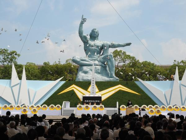 Doves fly over the Peace Statue during a memorial ceremony to mark the 70th anniversary of the atomic bombing of Nagasaki on Sunday.