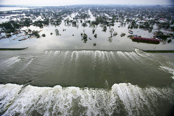 Water spills into New Orleans' Lower Ninth Ward through a failed floodwall along the Industrial Canal on Aug. 30, 2005, a day after Hurricane Katrina tore through the city