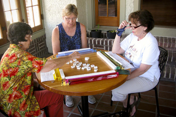 Cheri Babich (center) and her friends gather at the Broadmoor library for a weekly game of mahjong. Residents rallied to save the building after the low-lying area was designated to become a park in the aftermath of extensive Katrina-related flooding.