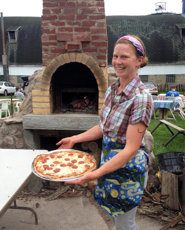 Kat Becker with a pizza on the farm.