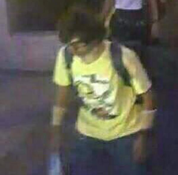 This image, released by the Royal Thai Police, shows a man near the Erawan shrine before an explosion occurred Monday in Bangkok. Authorities said Thursday he had been cleared.