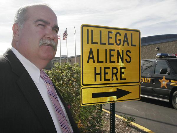 Butler County Sheriff Richard Jones stands next to a illegal aliens sign he had placed in the parking lot of the Butler County Sheriff's Department, Nov. 3, 2005, in Hamilton, Ohio.