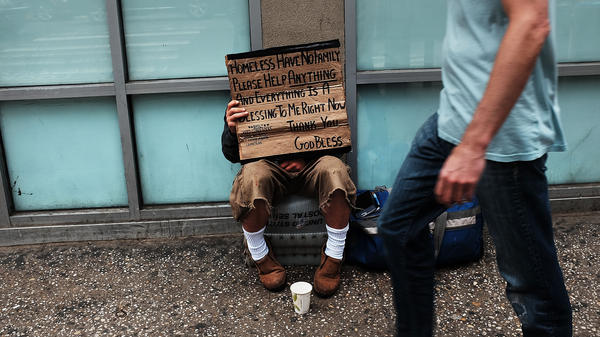 A homeless man panhandles along Manhattan's Eighth Avenue in New York City.
