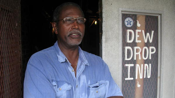 Kenneth Jackson stands outside the Dew Drop Inn, which his grandfather, Frank Painia, opened in 1938.