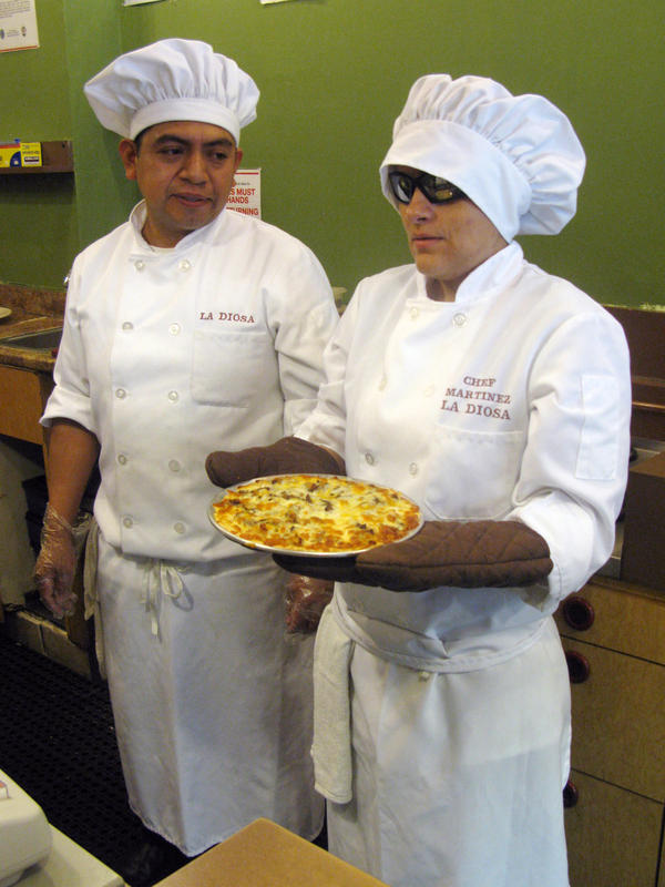 Chef Martinez and her husband, Maurilio Ortega, who also works at La Diosa, get ready to serve a tartizza. Martinez calls her creation something between a tart and a pizza, with a light, flaky crust.