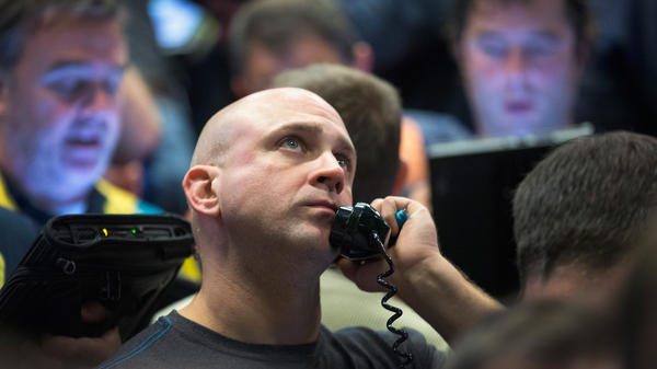 A trader fills orders Monday in the Standard & Poor's 500 stock index options pit at the Chicago Board Options Exchange. Watching market numbers plummet can make investors queasy, but analysts say keeping a level head through volatility is the best course.