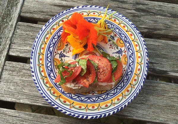 Kathy Gunst's End-of-Summer Tomato Tartine is a French-style open-faced sandwich with ripe tomatoes, fresh basil and fresh ricotta or goat cheese. (Kathy Gunst)