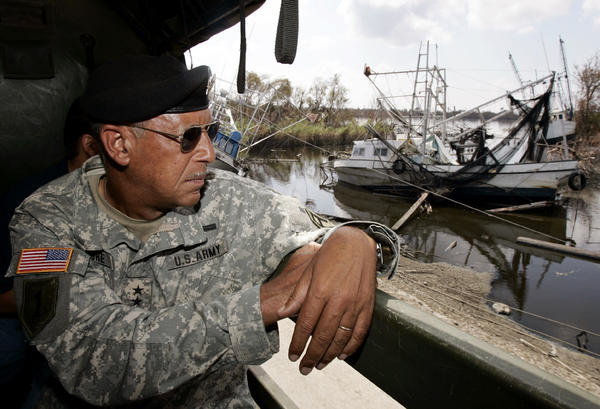 Army Lt. Gen. Russel Honore looks over extensive flood damage from Hurricanes Katrina and Rita in the town of Empire in Plaquemines Parish, La., on Oct. 1, 2005. Hurricane Rita hit a little less than a month after Katrina, and much of the area remained flooded.