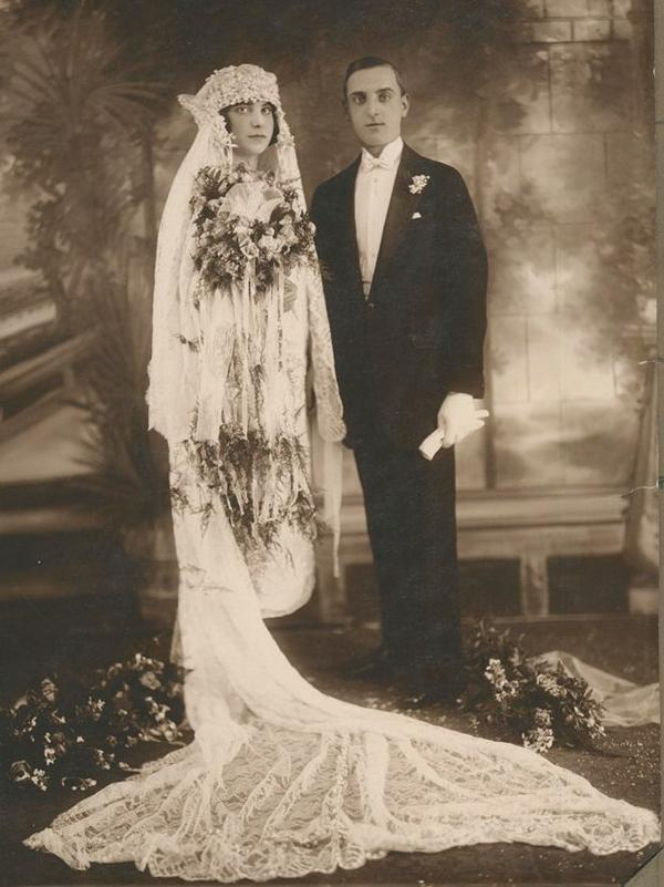 """Louise and Michael Toscano, mother and father of Brooklyn Public Library patron Vera Toscano, on their wedding day. The reception was at the Grand Paradise Ballroom in the Williamsburg neighborhood on May 9, 1926. The photo is now part of the """"Culture in Transit"""" online collection."""