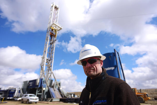 Paul Ulrich of Jonah Energy stands in front of a drilling rig in Sublette County, Wyo. Jonah Energy has more than 1,600 producing wells in Sublette County, most of them dotting a broad mesa that's prime sage grouse habitat.