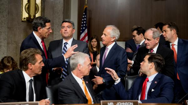 Sen. Bob Corker (center, standing) speaks with fellow Republican senators before a hearing on the Iran nuclear agreement. Corker opposes the deal, but was among the architects of rules that make it hard to stop the agreement.