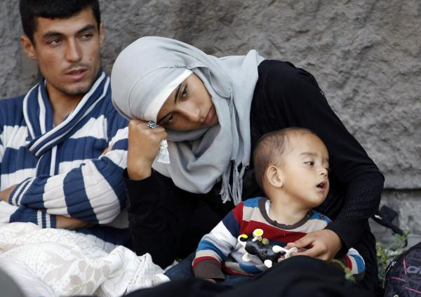Migrants rest near the Keleti Railway Station in Budapest, Hungary, on Wednesday.
