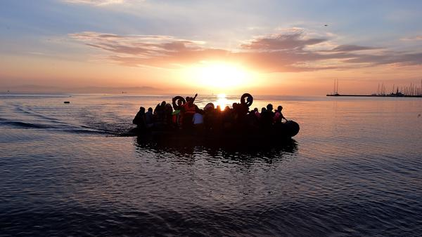 Syrian migrants in an overcrowded dinghy from Turkey arrive on the Greek island of Kos on Aug. 29.