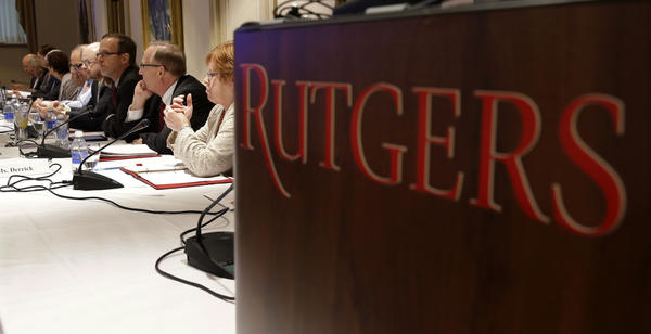 After five football players were arrested Thursday, Rutgers University suspended the group. Two other former players are also suspected of crimes that range from assault to robbery. Here, the school's board of governors is seen in a meeting this summer.