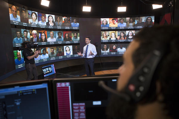 Professor Bharat Anand of Harvard Business School teaches students all over the world live from a television studio.