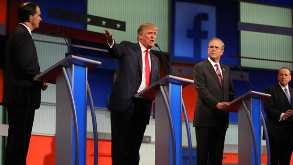 Republican presidential candidates (from left) Scott Walker, Donald Trump, Jeb Bush and Mike Huckabee take the stage for the first Republican presidential debate.