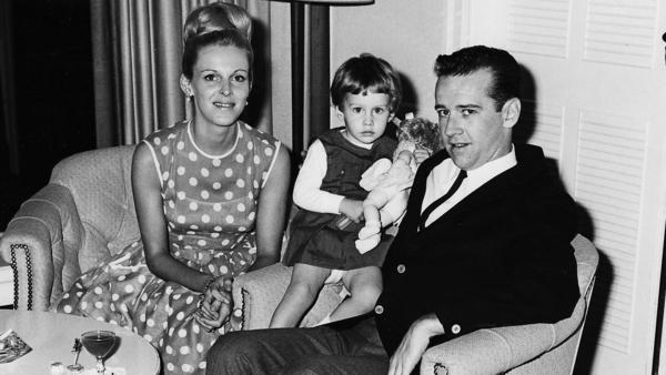 """Kelly Carlin (center) says her parents, Brenda and George Carlin, could never be accused of hovering over their only child — she says her dad was """"the ultimate laissez faire parent."""""""