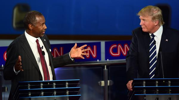 Republican presidential hopefuls, retired neurosurgeon Ben Carson and real-estate mogul Donald Trump talk about childhood vaccines during the second Republican presidential debate.