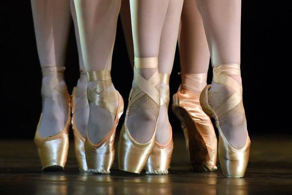 """Dancers from the Royal Ballet perform a scene from """"Song of the Earth"""" during a dress rehearsal in 2015. (Timothy A. Clary/AFP/Getty Images)"""