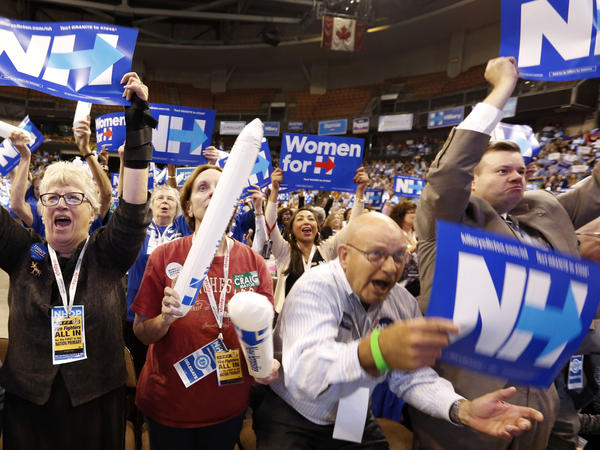 Supporters of Democratic presidential candidate Hillary Clinton cheer as she arrives at the state's annual Democratic convention Saturday in Manchester, N.H.