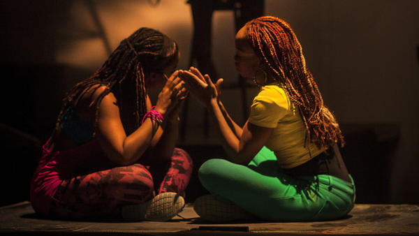 Dancers Catherine Foster (left) and Camille Brown play a clapping game in <em>Black Girl: Linguistic Play</em>.