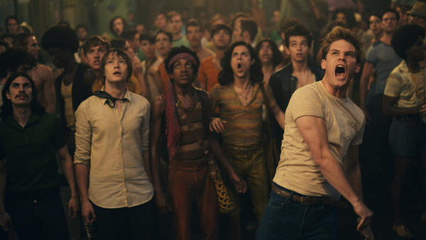 In <em>Stonewall,</em> actor Jeremy Irvine (right) plays a fictional high school student from Indiana who throws the brick that starts the Stonewall riots.