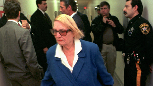 """""""She was not the kind of person to go away quietly,"""" said an attorney at the nonprofit that represented Vera Coking. Here, Coking is seen walking past Donald Trump in an Atlantic City, N.J., court."""