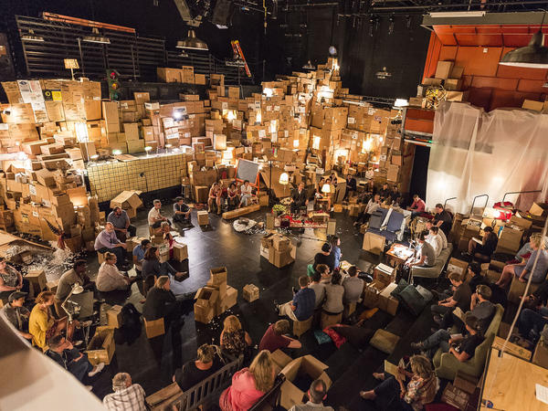 Boxes of all shapes and sizes are everywhere — on the floor, covering the seats, stacked halfway to the rafters.