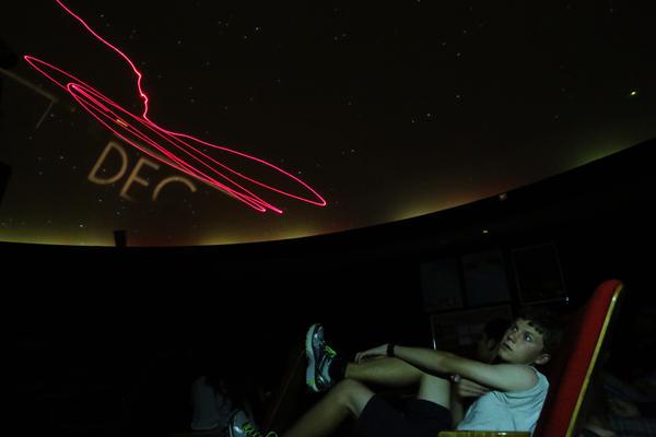 Jasper Barnett, a junior at Thomas Jefferson High School for Science and Technology in Alexandria, Va., looks up in the school's planetarium.