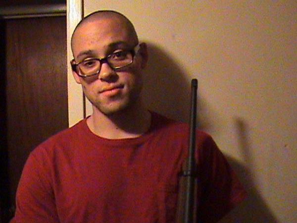 This undated photo from a MySpace page that appeared to belong to Chris Harper Mercer shows him holding a rifle. Authorities identified Mercer as the gunman who went on a deadly shooting rampage at Umpqua Community College in Roseburg, Ore., on Thursday.