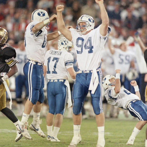Chaffetz (right) in 1988, then a kicker for BYU, falls to the ground after kicking the winning field goal against Colorado in the Freedom Bowl.