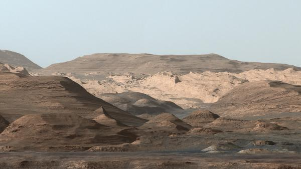Mars' massive Mount Sharp may have formed billions of years ago as water carried sand and silt into the center of a large crater.