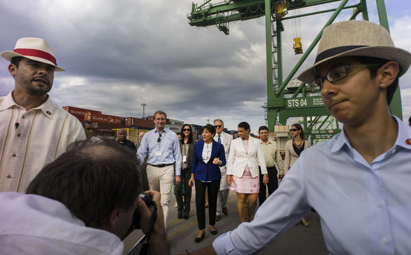 U.S. Commerce Secretary Penny Pritzker (in blue jacket), visits the container port at the Special Enterprise Zone in Mariel, Cuba, on Oct. 6. Cuba is creating the zone to encourage trade and foreign investment. Some foreign companies are eager to move in, though the Pritzker said Cuba's commitment to free trade was not year clear.