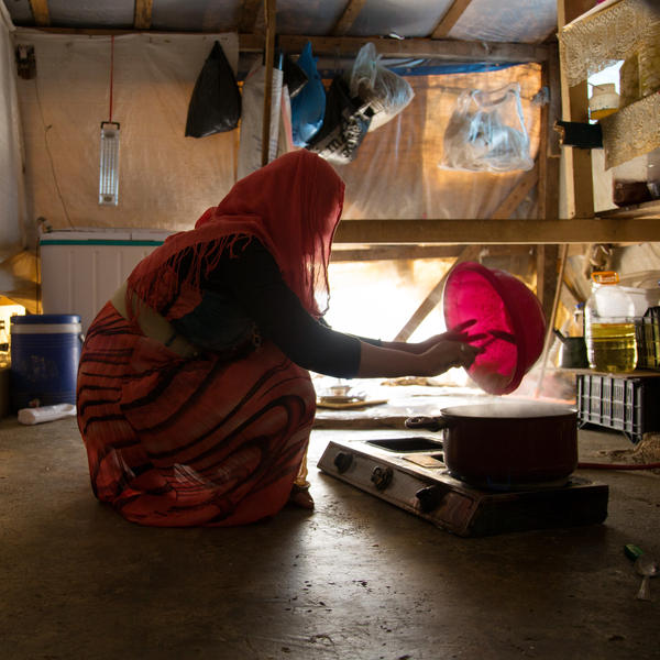 Fatmeh prepares lunch for her mother and her six siblings in the camp.