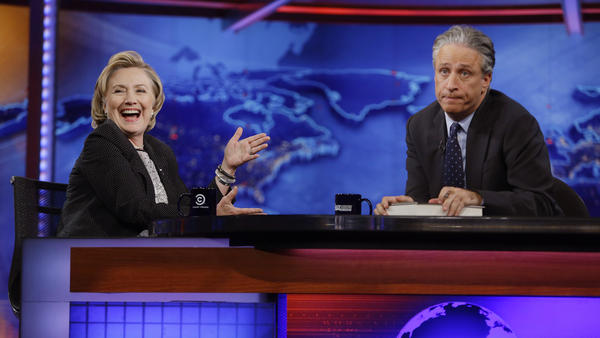 Hillary Clinton reacts to host Jon Stewart on <em>The Daily Show</em> in 2014. According to a new survey, Bernie Sanders' supporters are more likely to watch the show than are Clinton's supporters.