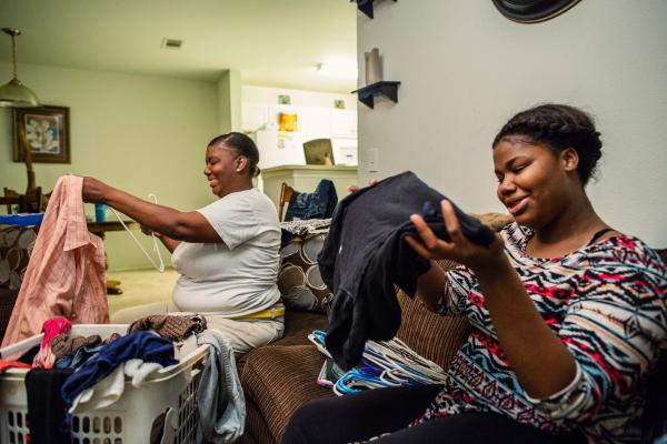 Kennedy and her daughter Victorya Ricks, 17, fold laundry at her home in D'lberville, Miss., a 10-minute drive from Biloxi.