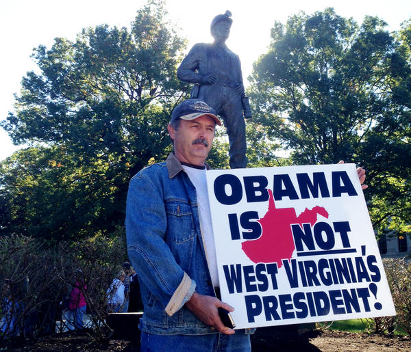 Standing next to the Coal Miner's Statue at the West Virginia Capitol in Charleston on Wednesday, James Bennett rallied alongside other speakers who criticized President Obama's proposed environmental rules that would limit carbon emissions from coal-fired power plants. The rally coincided with president's visit to the state capital to talk about drug abuse.