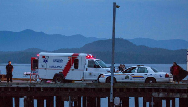 Rescue personnel, mounting a search for victims of a capsized whale-watching boat, park on a wharf in Tofino, British Columbia, on Sunday.
