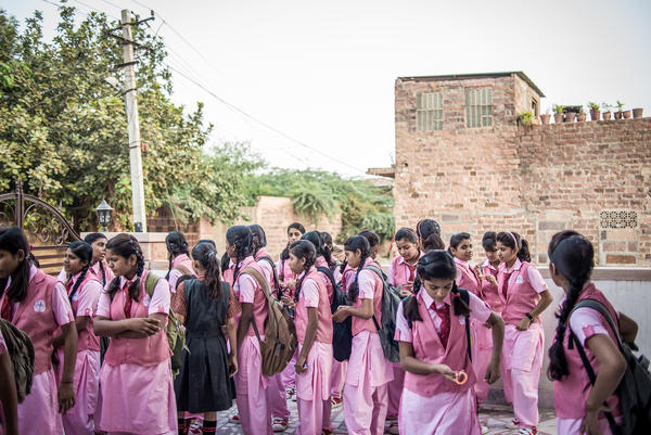 Some of the 70 students at the Veerni Institute gather in the courtyard, waiting for the first bell to ring.