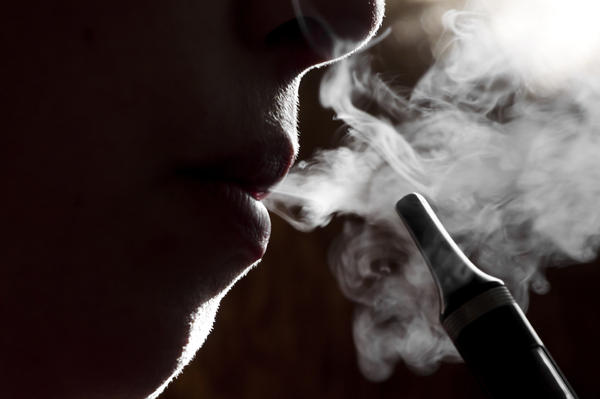 E-cigarettes work by heating up a fluid that contains the drug nicotine, producing a vapor that users inhale. The devices are most popular among young adults, ages 18 to 24, a federal survey indicates.