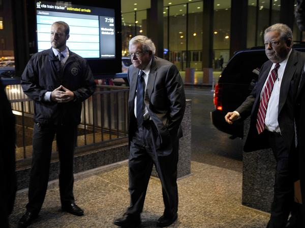 Former House Speaker Dennis Hastert (center) arrives at the federal courthouse Wednesday in Chicago.