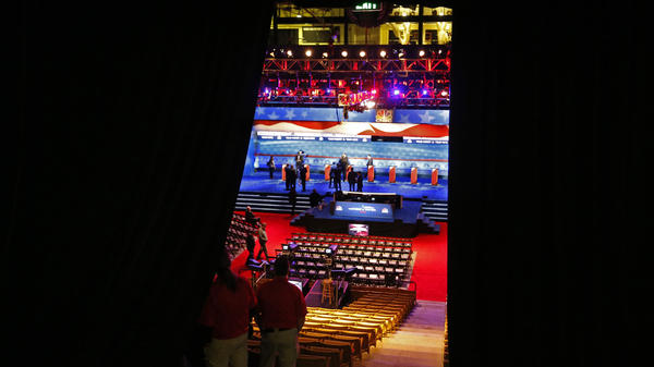 Workers prepare the stage before the CNBC Republican presidential debate Wednesday.