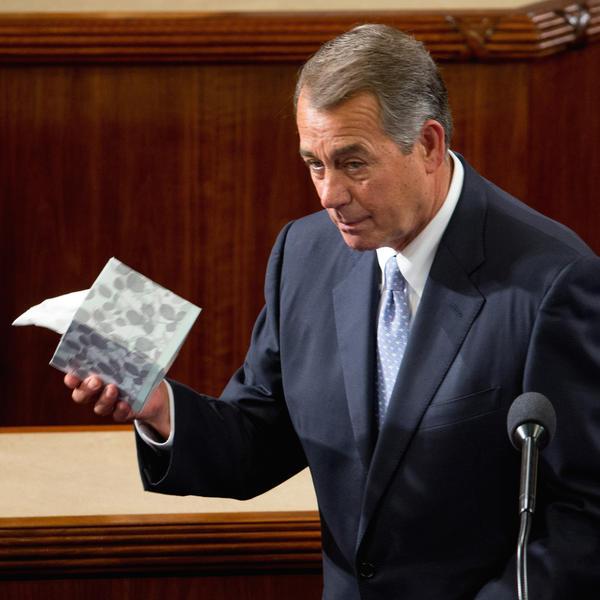 Boehner of Ohio held up a box of tissues as he prepared to speak Thursday.